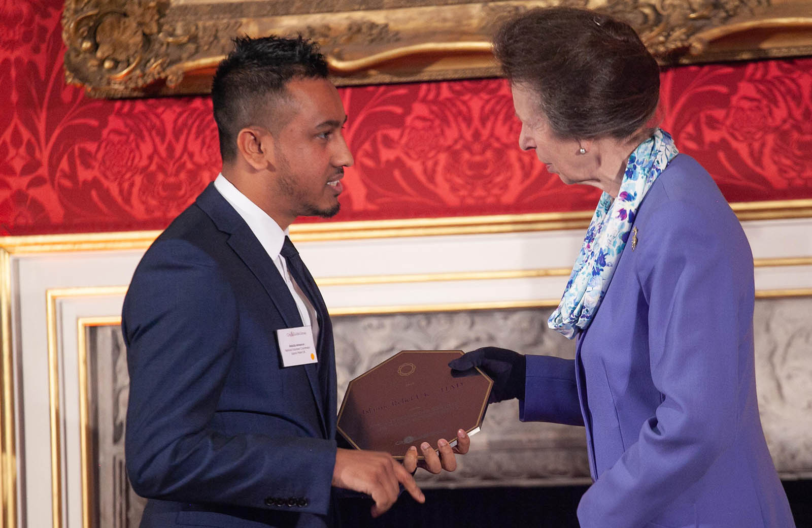 Abdulla Almamun, National Volunteer Coordinator, receiving  awarded The Princess Royal Training Award on behalf of Islamic Relief for our AimIR programme.