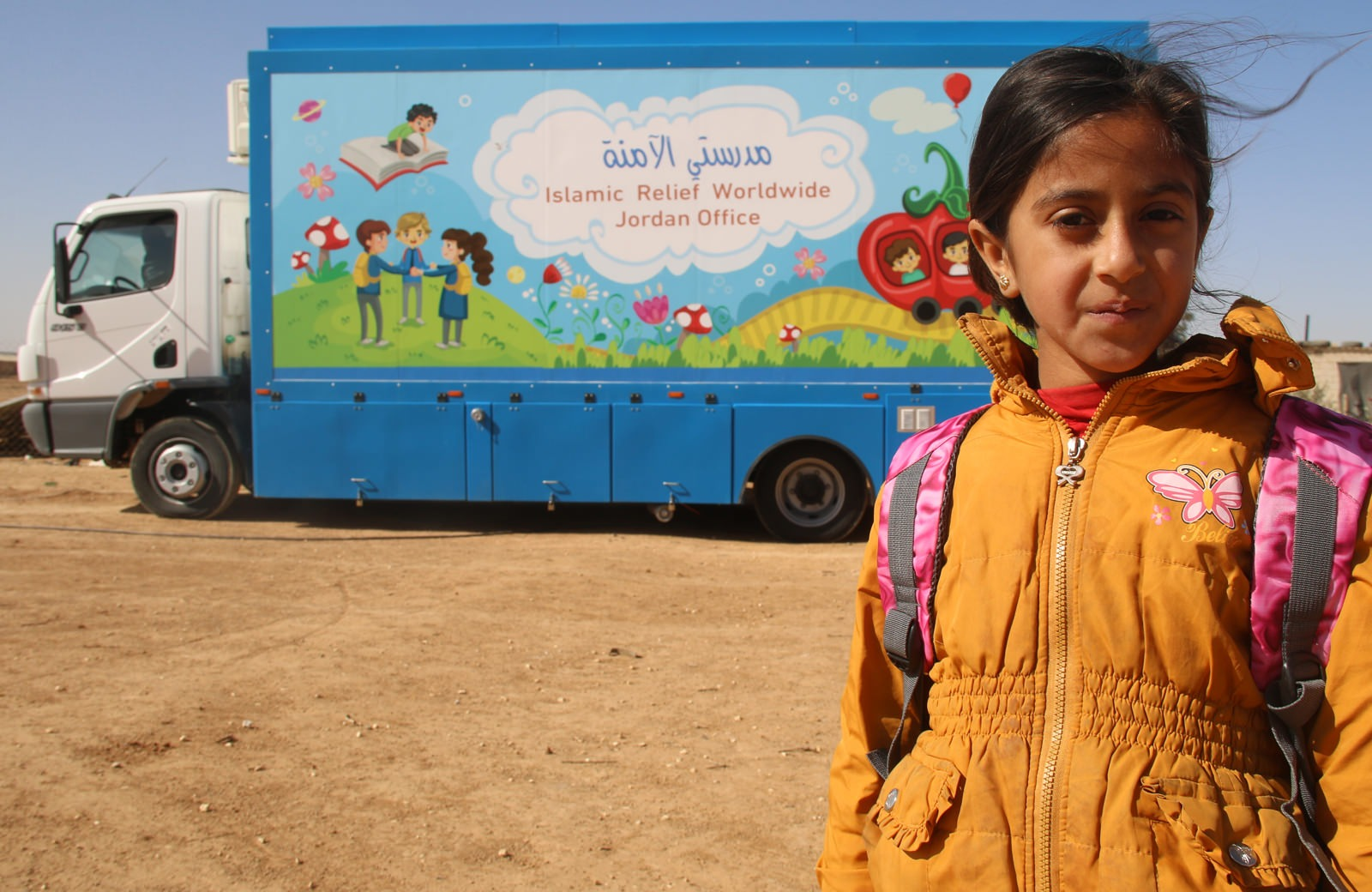 Hanaa and the Islamic Relief mobile education bus in Jordan, providing education for hundreds of children in need