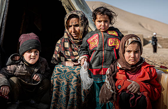 Afghan family in a camp